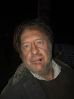 Glenn as William, the homeless opera singer in the movie, Shaking Cup.